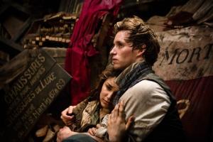 Eddie Redmayne as Marius and Samantha Barks as Eponine