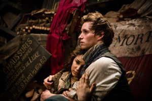 Eddie Redmayne as Marius and Samantha Barks as Eponine